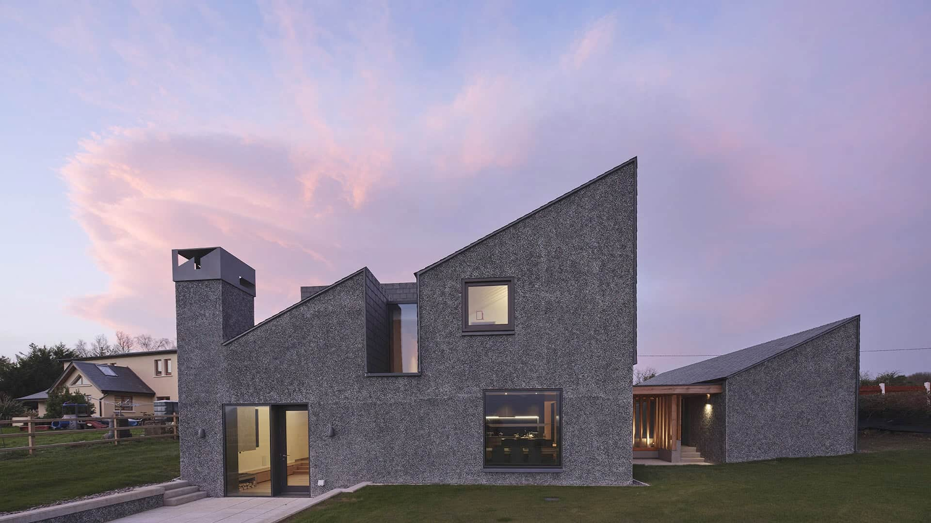 A new Irish house with a modern hardy pebbledash/crushed-slate-dash finish, and a stupendous view